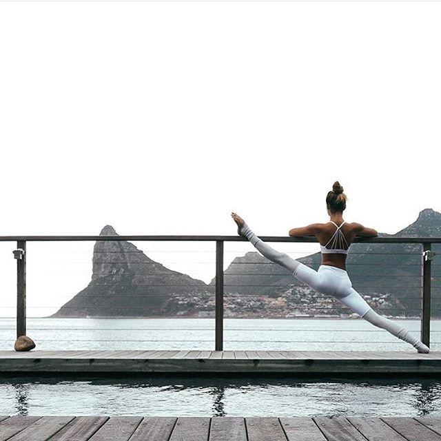 """Always be on the lookout for the presence of wonder."" - E.B. White.  @SjanaElise is featured in the Sunny Strappy Bra & Goddess Legging. #aloyoga #beagoddess #regram"
