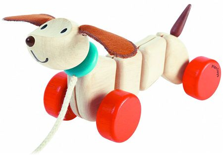 Perky ears and a smiling mouth are hard to resist. Children take Puppy for a walk, and Puppy's segmented body wiggles and wags with delight as he is pulled this way and that. #EcoFriendly #PlanToys