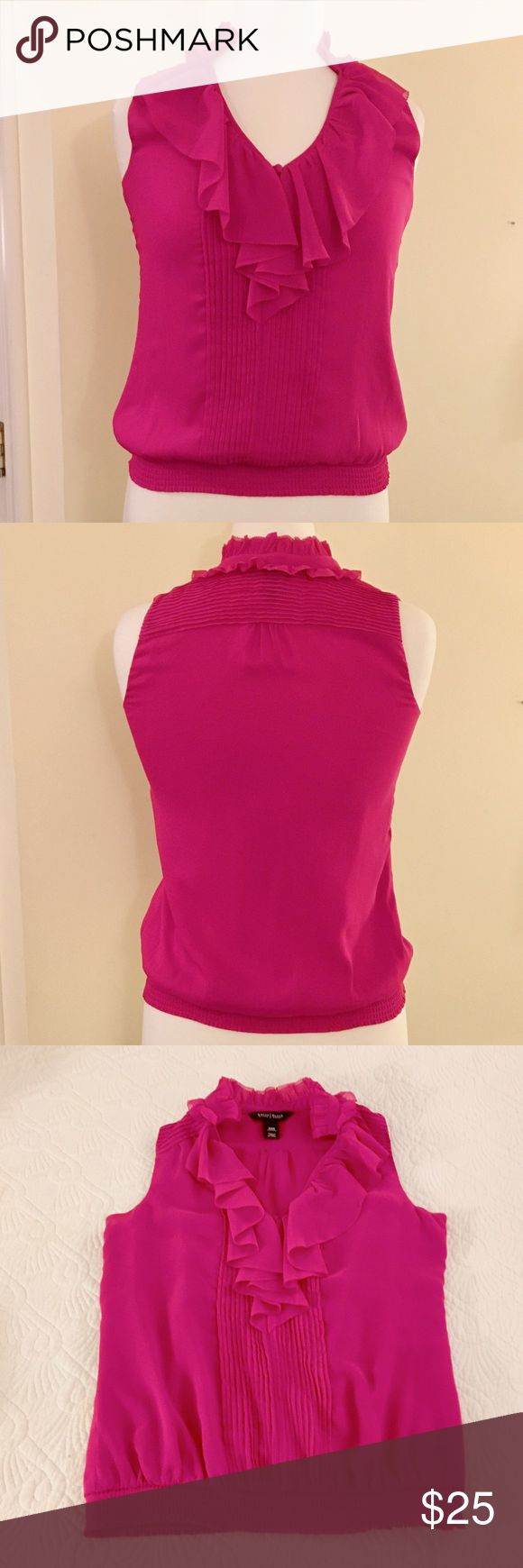 """White House Black Market Fuschia Sleeveless Blouse White House Black Market Fuschia Sleeveless Blouse.  Ruffle neckline and stretchy hemline.  100% Polyester.  So adorable under a blazer for a day at the office. When lying flat, bust is 16"""" across and length from top of shoulder to bottom of hem is 21"""".  Great condition.  Size XXS. White House Black Market Tops Blouses"""