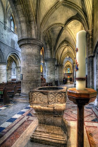 The Hospital (hospitality) of St Cross in Winchester, UK, was founded in 1136 and was a home for 13 poor men. The Church was not finished until the 13th century and therefore spans the Norman and early English styles of architecture. Its architecture is stunning.
