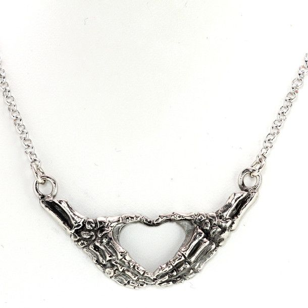 Skeleton Hands Necklace... slightly disturbing... actually really cool too.... in that weird twisted way that bones are trying to be romantic...