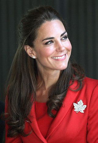HALF UP WITH VOLUME For her last day in  Canada (July 8th), the Duchess wore a red coat dress and pulled her hair into a sleek half up style with height in front and loose curls at the ends.