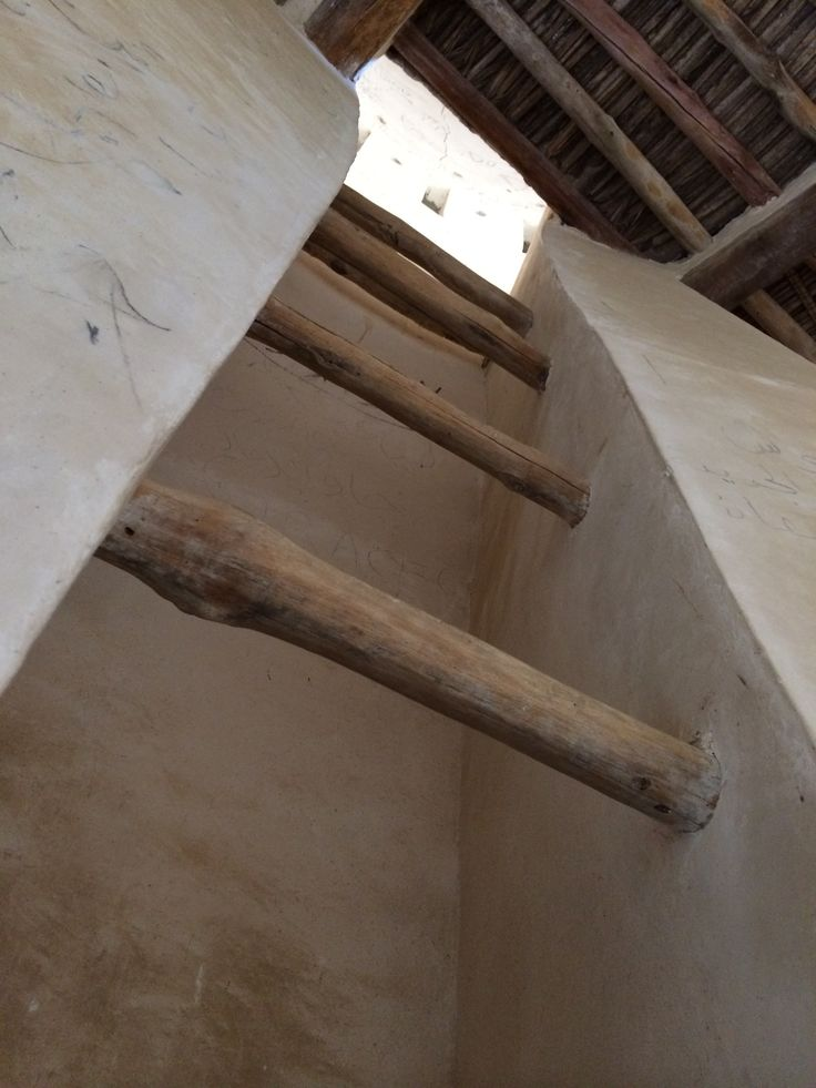 Ladder going to top of tower in ghost town Jazeera Humrah