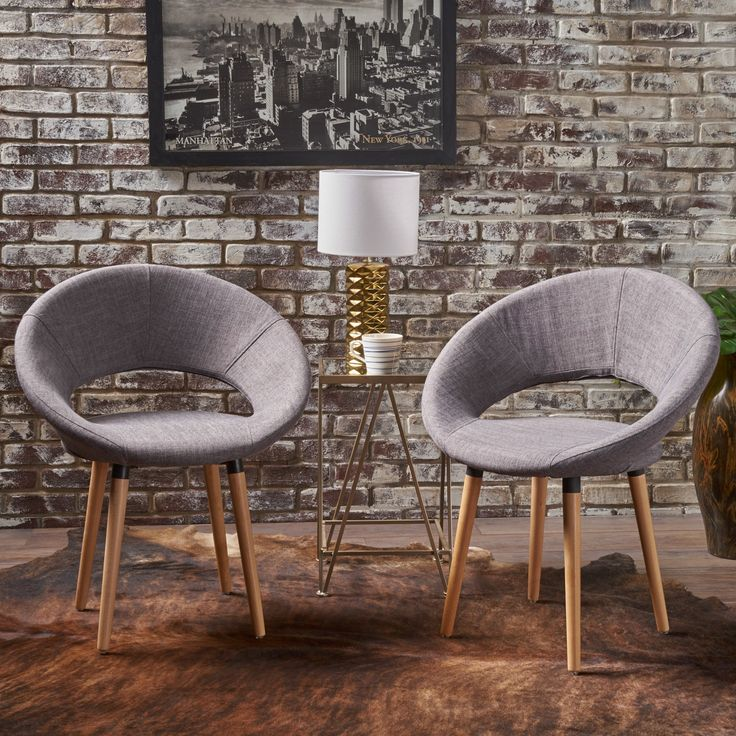These modern Christopher Knight Home Keegan Dining Chairs (Set of 2) are a wonderful way to add a little something extra to your dining space. As comfortable as traditional dining chairs, these modern chairs will not only elate your guests, but also keep the conversation flowing as you dine in comfort and style.