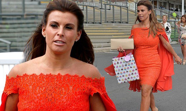 Coleen Rooney suffers a fashion fail in tight tangerine caped dress