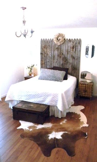 Would totally not do cowhide. But a fence headboard! Imagine shabby chic white against gray wall! -Rustic/Vintage Bedroom. Cow-hide rug and fence headboard!