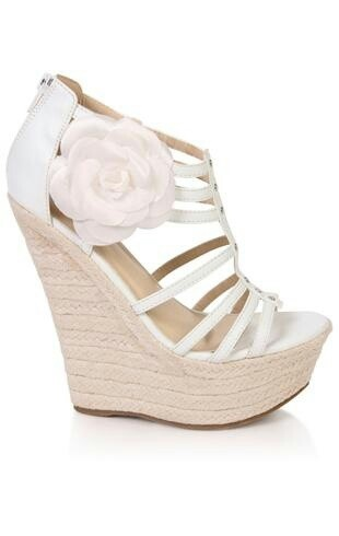 nice shoes, could do without the flower.