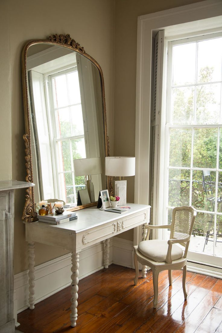 A marble-topped vanity gets an extra dose of French elegance thanks to a gilded mirror.
