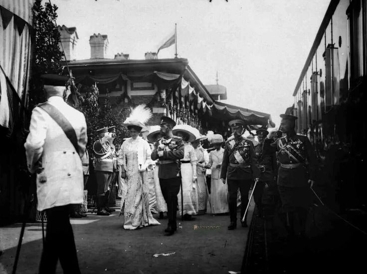 EMPEROR NICHOLAS II, EMPRESS ALEXANDRA FEODOROVNA AND DAUGHTERS  With their attendants on the platform of the train station upon arrival at Borodino station to participate in the celebrations on the occasion of the 100th anniversary of the War of 1812. Photo KE . von Hahn and K °.  Borodino, August 25, 1912.