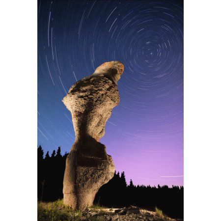 Light painting on monolith and star trails Anse des Bonnes Femmes at Ile Niapiskau Mingan Archipelago National Park Reserve of Canada Cote-Nord Duplessis region Quebec Canada Canvas Art - Yves Marcoux