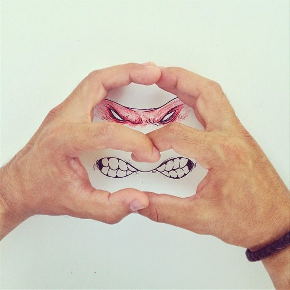 Drawings and hands by Alex Solis