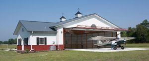 Aeromercado - Vizoni - Casas-hangar de madeira