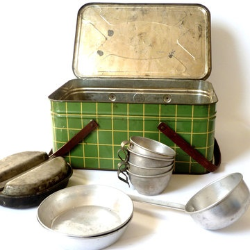 Green plaid picnic basket with metal dishes