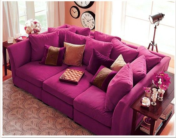 oh this is definitely mine. I must Have! our next apartment this would be perfect. large enough to sleep on and the most brilliant color :D  lots of pillow too LOVE IT