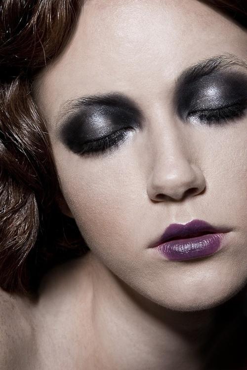 Bold - dark black/ grey eyeshadow up to brows, purplish-brown cupid bow lips.