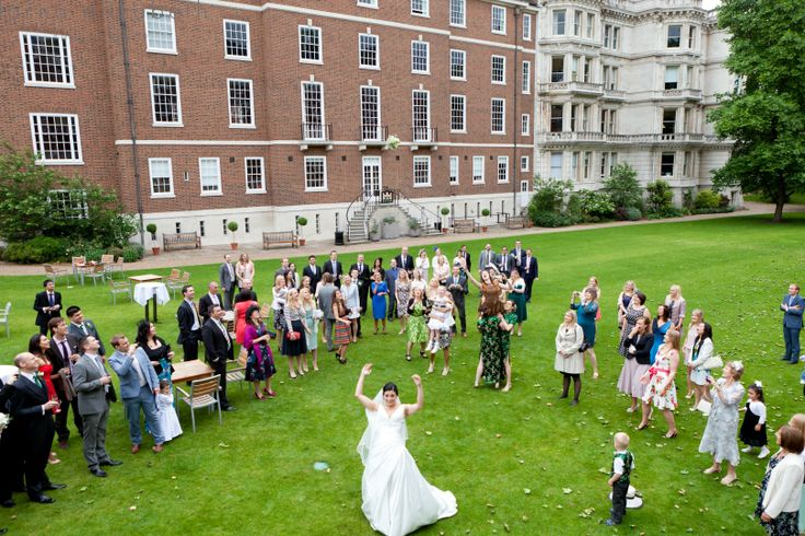 The bride throwing her bouquet in Middle Temple garden