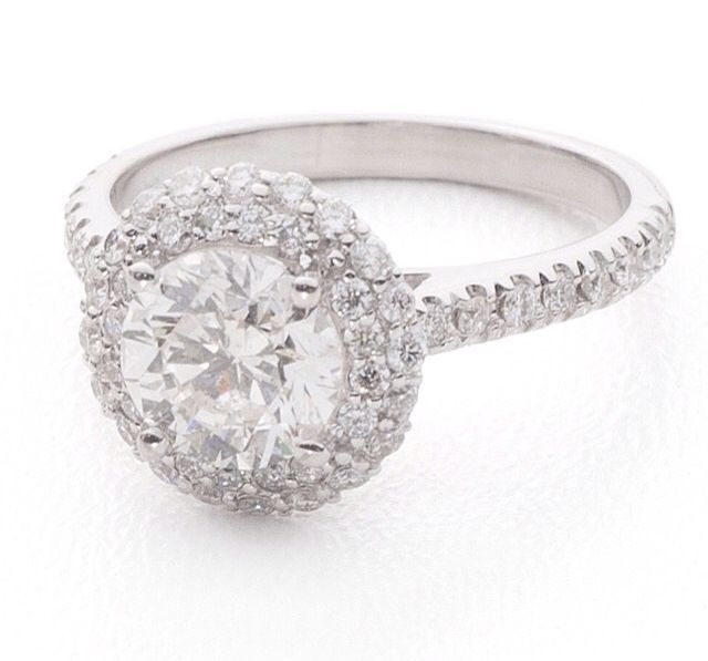 Ring. Round centre diamond with double halo, set in gold. Hand made by Jenny Greco