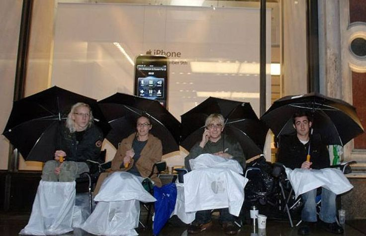 UK customers queue in the rain outside the Apple Store in London → The UK had to wait until November to get their hands on the iPhone. As the release date approached, fans queued through the night in the pouring rain.