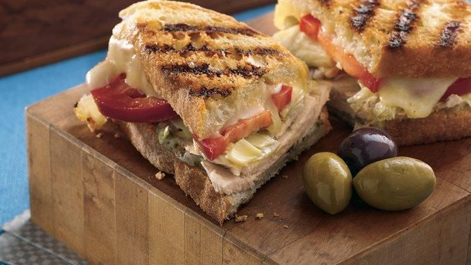Make crusty turkey-and-cheese panini with an Italian edge thanks to artichoke hearts and a schmear of pesto mayo. Try it as a surprising new use for those turkey leftovers!