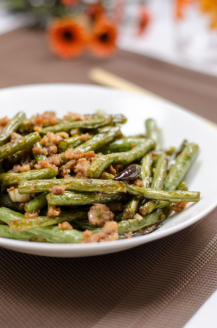 A classic Szechuan stir fried dish that makes green beans irresistible. Top on rice to make a delicious one-bowl meal!