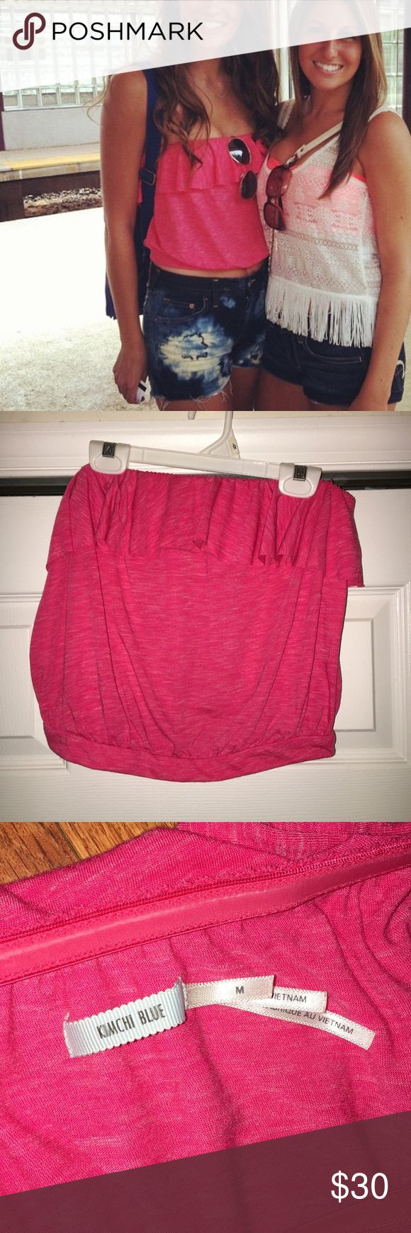 Pink Cropped Strapless Tank w/ Ruffle Super fun and comfy pink crop top.  Silicone adhesive lines the top to help it stay up, but doesn't pinch or bind in that unflattering underarm area!  Looks great with high wasted shorts or a skirt.  Size M but fits a small. Kimchi Blue Tops Crop Tops