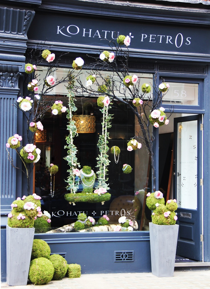 Spring window display. Beautiful soft colours - love the idea of bringing the window outside!