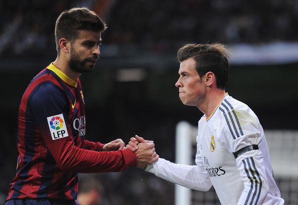 Gerard Pique (L) of Barcelona shakes hands with Gareth Bale of Real Madrid during the La Liga match between Real Madrid CF and FC Barcelona at the Bernabeu on March 23, 2014 in Madrid, Spain.