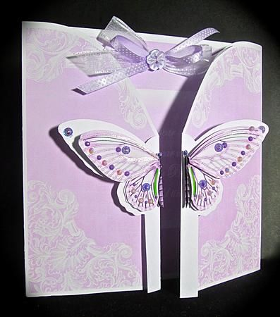 Lilac Butterfly Old Timer 3D Gatefold Butterfly MKit by Cynthia Massey Printed all sheets onto 200gm card and followed the easy instructions using a glue stick to glue the pieces back to back so no white shows, added an extra layer to the top part of the butterfly wings, layering with foam pads, added gems and sparkle to the butterfly and to complete and add texture I added a co-ordinating bow.