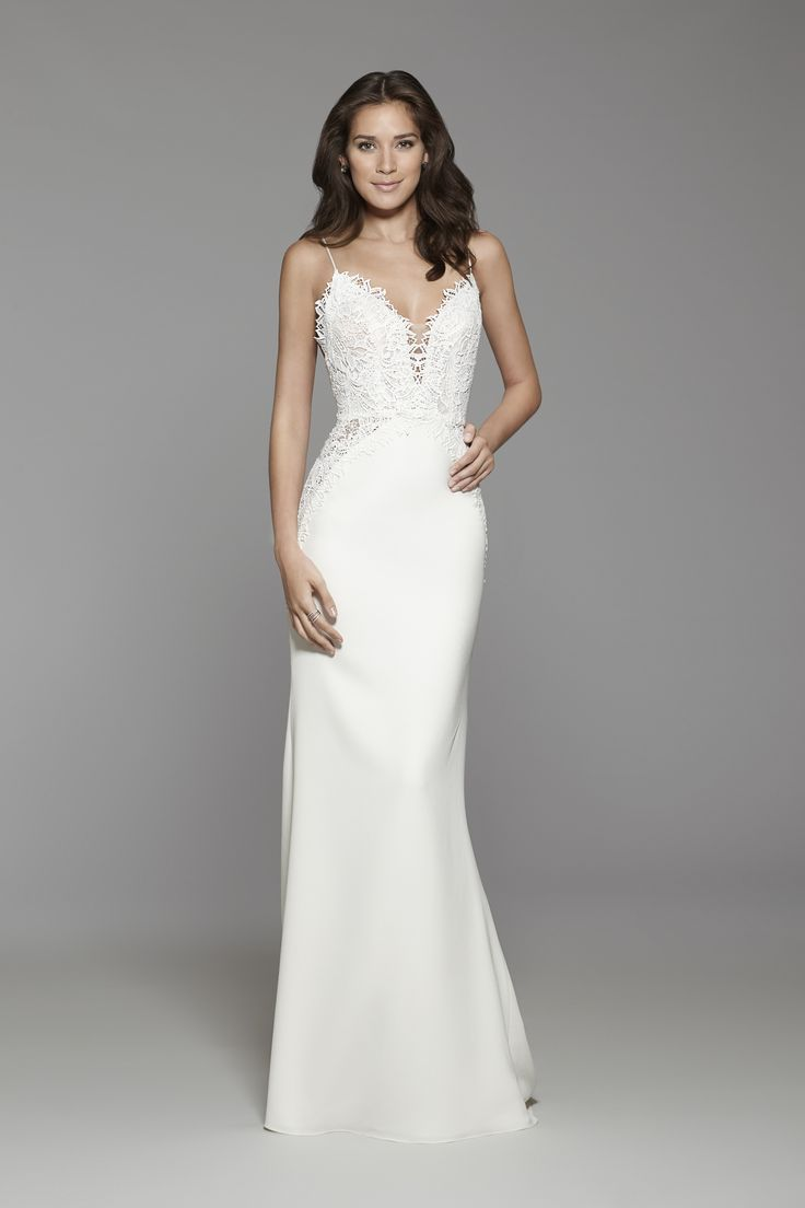 Tara Keely Bridal Style 2762 - Ivory crepe trumpet gown, scalloped floral Venise lace bodice, deep V neckline with Spaghetti straps, cut out side panels at hip and chapel train.