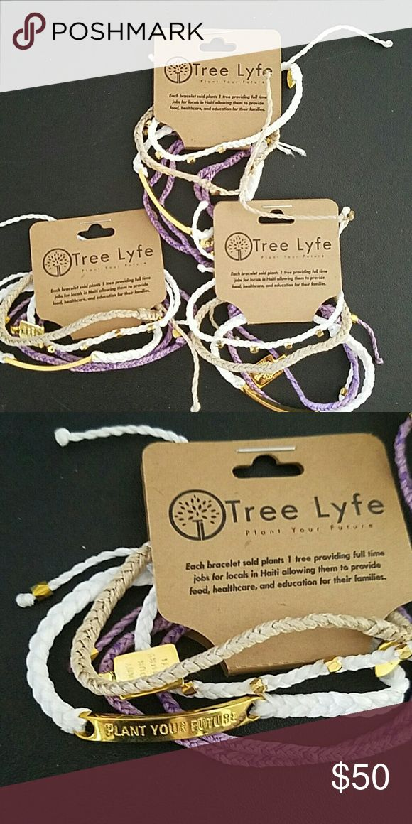 """Tree lyfe stacked """"plant your future"""" bracelets Purple gold white and tan stacks. One white braided bracelet has a gold plated piece saying """"plant your future"""". Each purchase helps provide full time jobs in Haiti while planting trees!!??????? tree lyfe Jewelry Bracelets"""