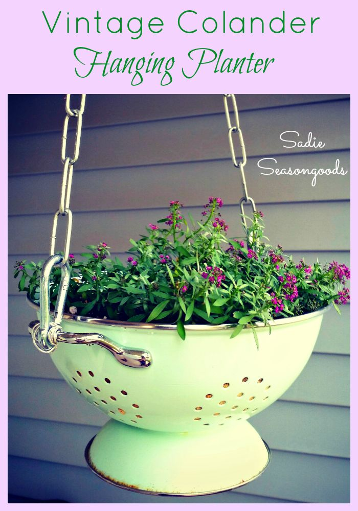 Add vintage charm to your front porch by converting an antique enameled kitchen colander into a fun AND functional hanging planter! It comes complete with drainage holes and the handles make it super easy to hang! Perfect for vintage colanders that have rust or other wear and tear. #SadieSeasongoods
