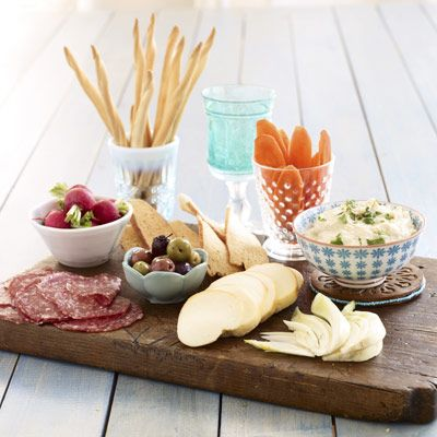 This bountiful antipasto platter makes an easy and fast party appetizer.   Serve: hummus, sliced cheese, thinly sliced fennel, thinly sliced salami, radishes w/salt, etc.