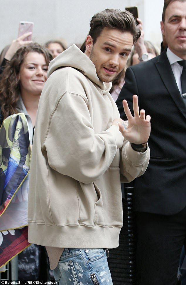 In high spirits: The former One Direction singer, 23, flashed a big grin as he headed off, cutting a casual figure in a beige hoodie