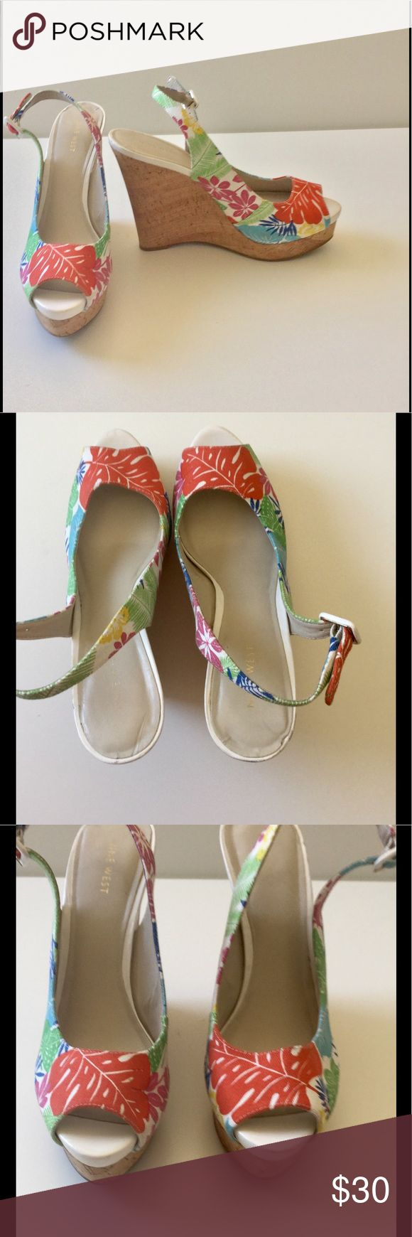 """🆕Listing Floral Platform Wedges 🎉HP🎉 Add summer flair with these Floral print canvas sling back wedges with cork sole. So cute with the FP crops, Bermudas & skirts and dresses! Adjustable buckle strap. 5.5"""" heel on a 1"""" platform. Cushioned footbed. Good pre-loved condition. Heel is in good condition. Some wear on cork shown with HD photo not very noticeable on 🎀Bundle discount  ⭐️5 star rated Suggested User 🚭Smoke free home 🚫No trades please  😍Please ask"""