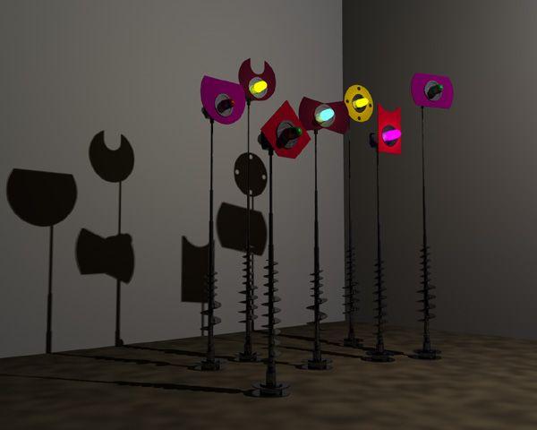 """Vassiliakis Takis 1925 Athènes. Dès 1954, développe une fascination pour le """"paysage technologique"""" des gares de triage, et entreprend une série de signaux lumineux, mobiles et verticaux. En 1958, il découvre les champs magnétiques qui vont constituer le fondement de son oeuvre. Ses sculptures de fer utilisent les ondes magnétiques causées par le courant électrique pour activer des sons musicaux aléatoires."""