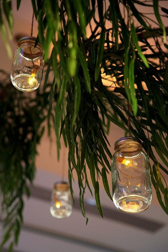 Add mason jars to traditional outdoor string lights to add a unique touch. Great for rustic weddings.