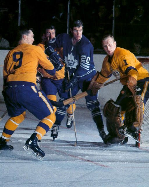 Bob Pulford of the Leafs surrounded by the Kings. Jack Norris between the pipes for LA.