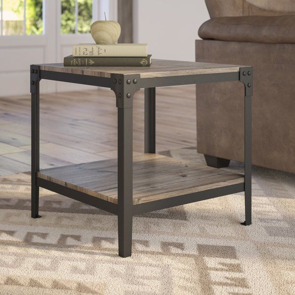 With its simple design and natural finish, this mixed-material end table is the perfect complement to a rustic ensemble. Featuring a powder-coated metal frame, this design incorporates two open shelves made from MDF in a woodgrain finish. For a comfortable setup in the great room, roll out a southwestern rug in the middle of the floor to define the space, then place one of these charming tables on each side of an oversized leather Lawson sofa with nailhead trim. Add two knotted wood accent…