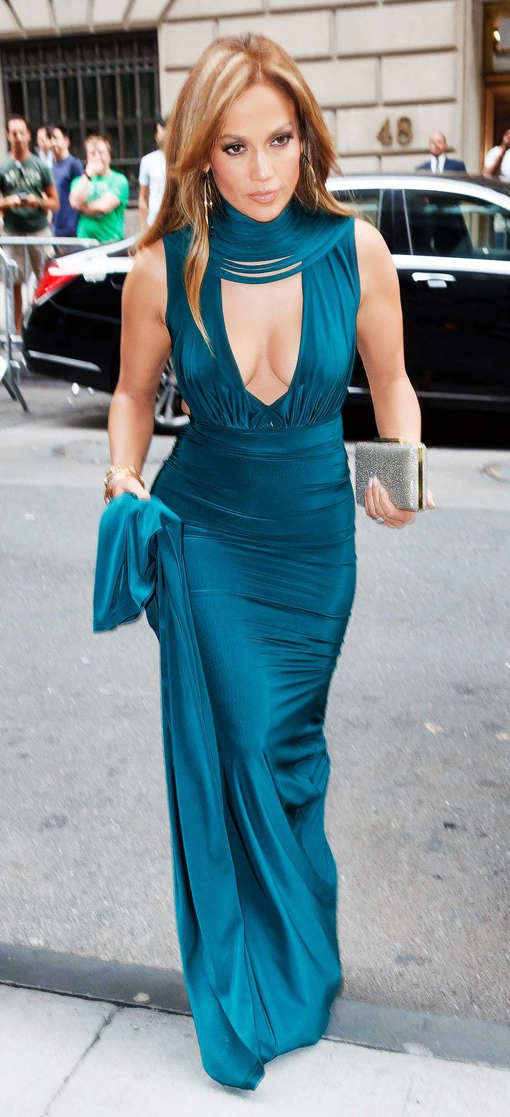- J.Lo attended in all her teal (aka, something blue) glory, courtesy of Serbian design house Hamel.