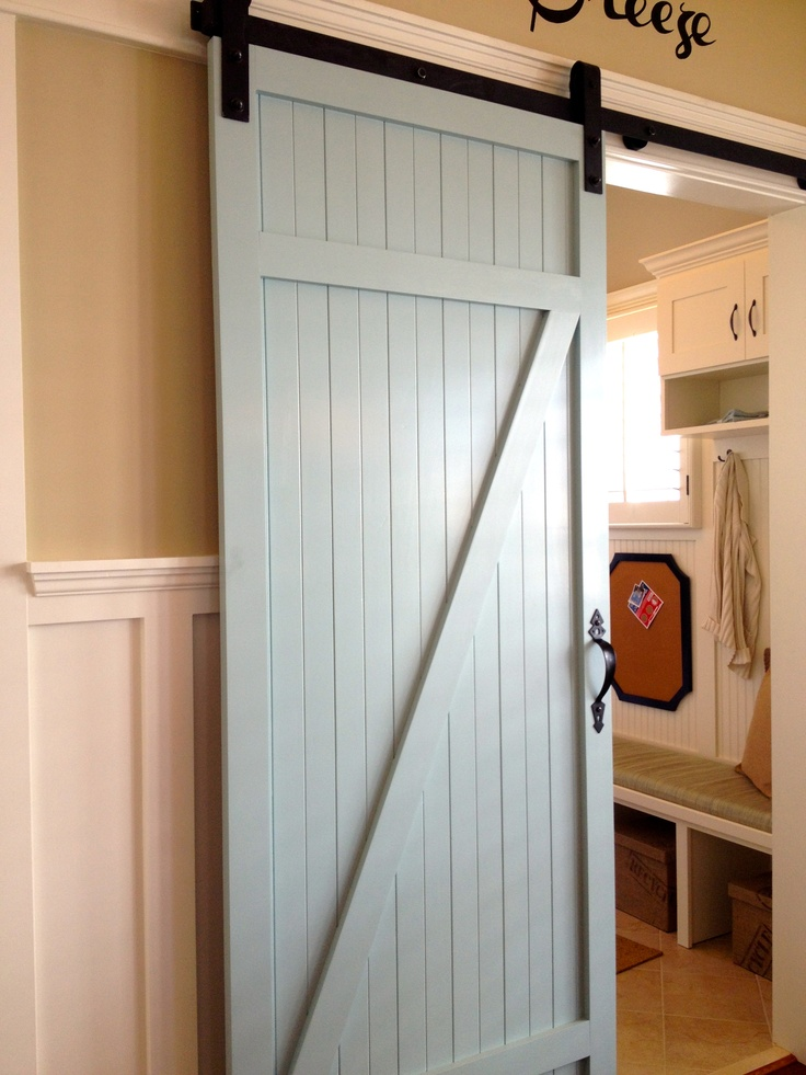 Beautiful Farm Door Separating The Laundry Room From The