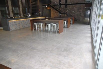 Non-exposed aggregate honed concrete floor colour