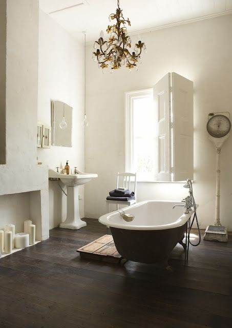 Vintage + country bathroom - love the candles in the fireplace & antique scale. Father Rabbit's Blog.