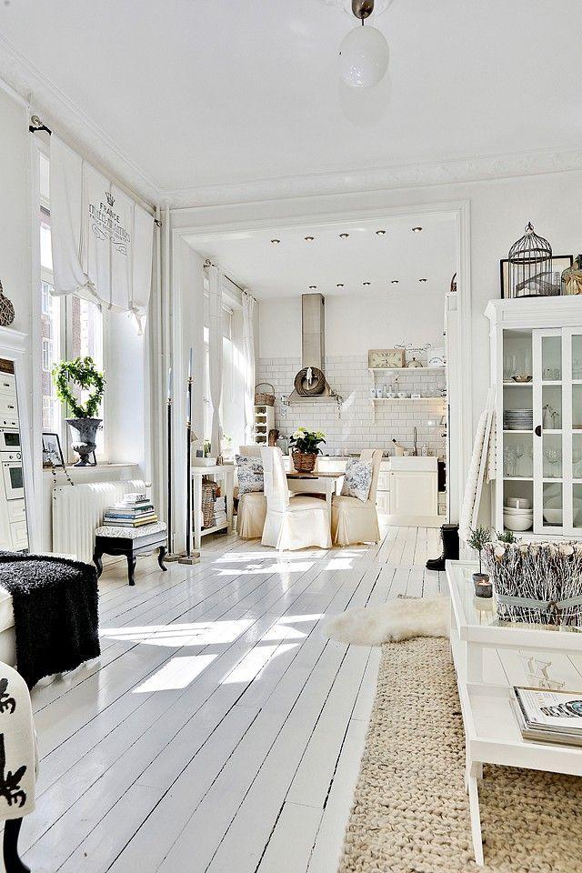 .love love love this white painted wood floor, white decor, sisal type rug & old dresser / unit