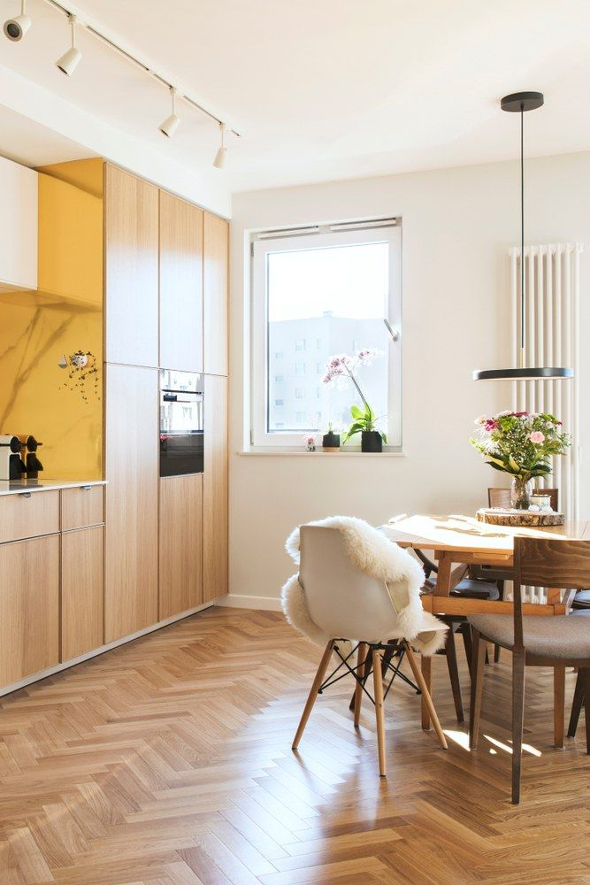 Modern Scandinavian Open Space Interior Of Kitchen And Dining Room With Design Furniture Black Fridge Marble Walls An Furniture Design Space Interiors Design