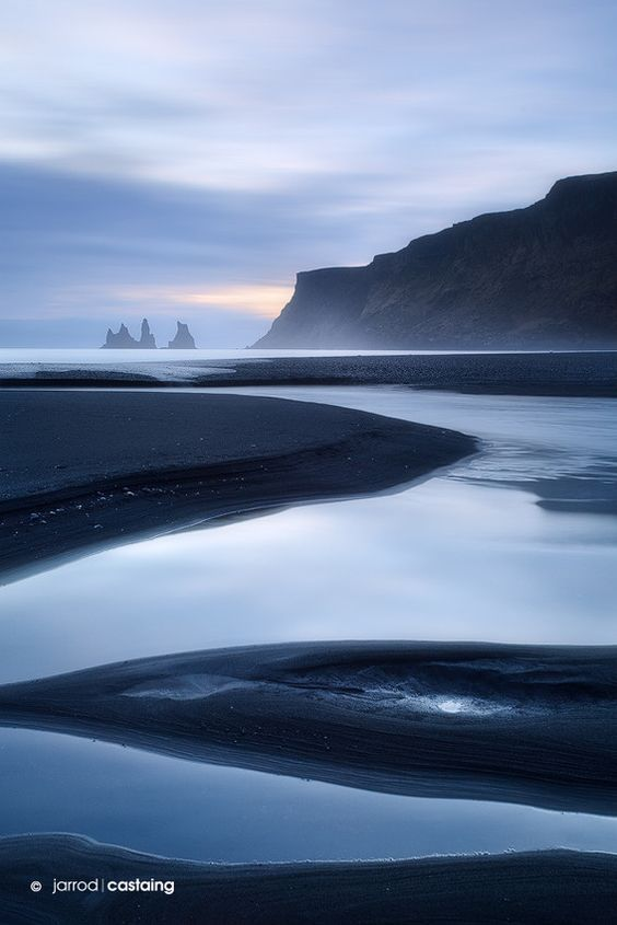 Sunset over black sand beach at Vik i Myrdal, South Coast, Iceland