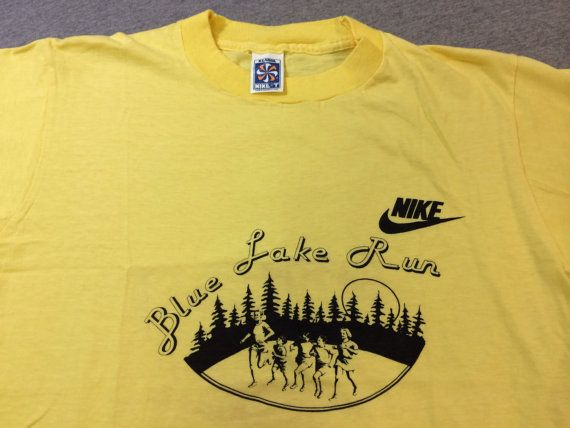 An original 70s Nike Pinwheel tag shirt. Very rare new old stock (unworn) Blue Lake Run. Perfect piece for all Nike collectors.  Condition: