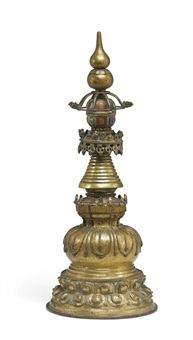 15th century circa, Tibet, gilt copper alloy  with stone inlay.