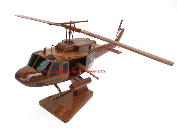"A beautiful hand carved desktop model of the UH-1D Huey. The model has been carved from solid mahogany. The model comes boxed and is simple to assemble. The rota's, tail fins and stand simply slot into pre-drilled holes on the body of the aircraft. No glue required. Size H 7"", L 17"", Rota 13"". Visit our website at thewoodenmodelcompany.co.uk to view the full range of our models."