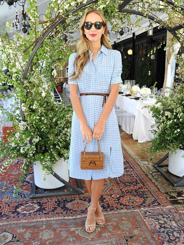 Harley Viera-Newton wearing a blue and white gingham dress and nude heels