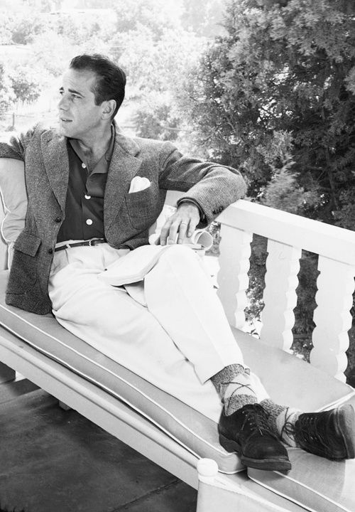 Humphrey Bogart casual style: ivory flannel pleated trousers, sack sportcoat with patch pockets, argyle socks, suede derby shoes, white pocket square